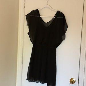 Sheer-sleeved  little black Express dress